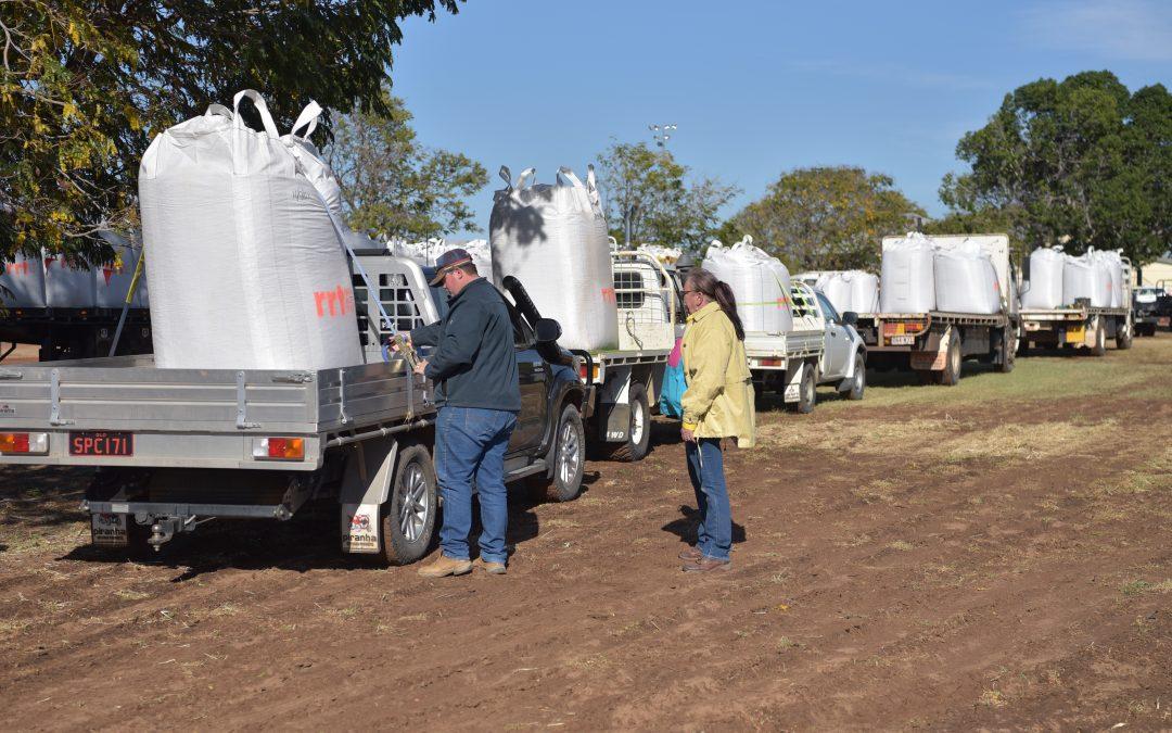Brethren Charity RRT distributing feed to farmers